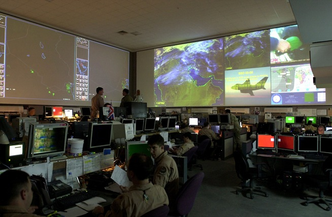 SOUTHWEST ASIA: Controllers in the Combined Air Operations Center at an air base on the Arabian Peninsula monitor the status of ongoing Operation Southern Watch missions. Spanning nearly 30,000 square feet, the CAOC is the nerve center for all U.S. Central Command air operations. (U.S. Air Force photo - Released)