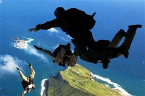 Air Force pararescuemen and Navy SEALs participate in free-fall parachute training Jan. 21, 2011, over Marine Corps Base Hawaii. The Airmen are assigned to the New York Air National Guard's 103rd Rescue Squadron. The SEALs are based on the West Coast. (U.S. Marine Corps photo/Lance Cpl. Reece E. Lodder)